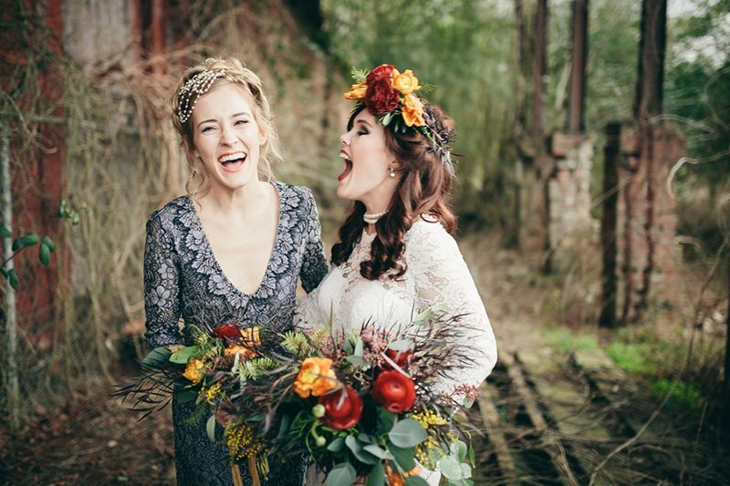 Industrial_Warehouse_Shoot-bride_and_bridesmaid_laughing
