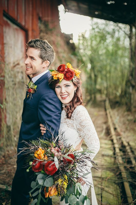 Industrial_Warehouse_Shoot-bride_and_groom_laughing_at_railroad_track