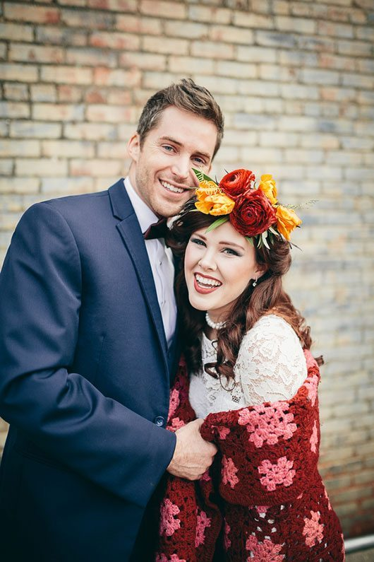 Industrial_Warehouse_Shoot-bride_and_groom_laughing_with_blanket