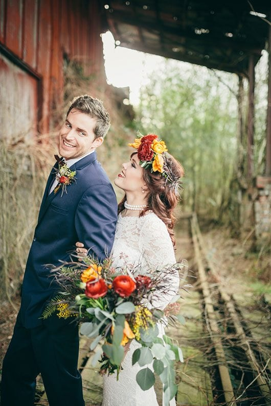 Industrial_Warehouse_Shoot-bride_and_groom_smiling_on_railroad_track