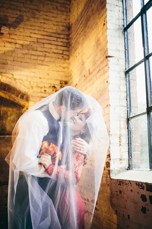 Industrial_Warehouse_Shoot-bride_and_groom_under_veil