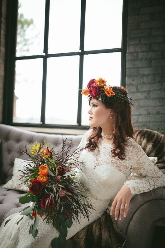 Industrial_Warehouse_Shoot-bride_sitting_on_couch_by_window