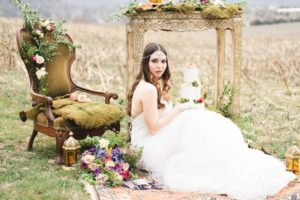 Outdoor_wedding_with_pops_of_color-bride_sitting_on_ground