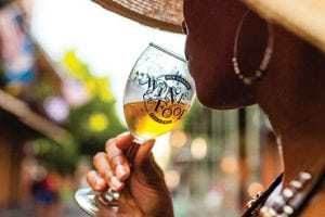 10 Things To Do In NOLA Woman Drinking Wine