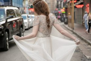 Anya_Gown-bride_walking_in_street_back_of_dress