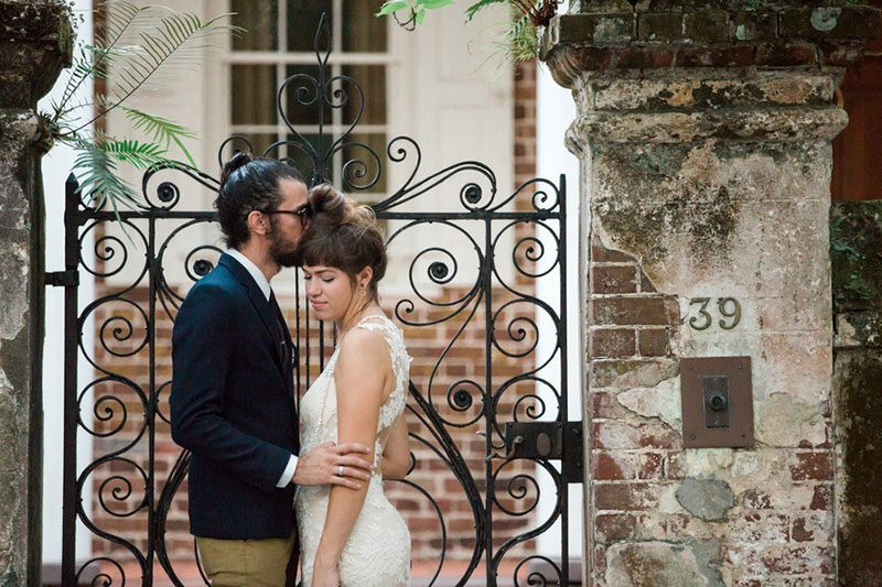 French_Boho-bride_and_groom_by_fence
