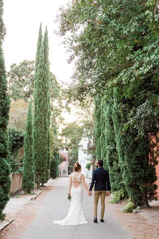 French_Boho-bride_and_groom_holding_hands