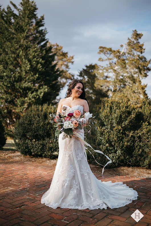 Modern_rustic_wedding-bride_holding_flowers_and_smiling