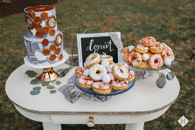 Modern_rustic_wedding-cake_with_donuts_and_desserts