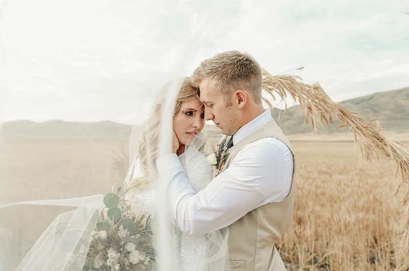 Bountiful Wheat Harvest Bride And Groom In Field With Veil