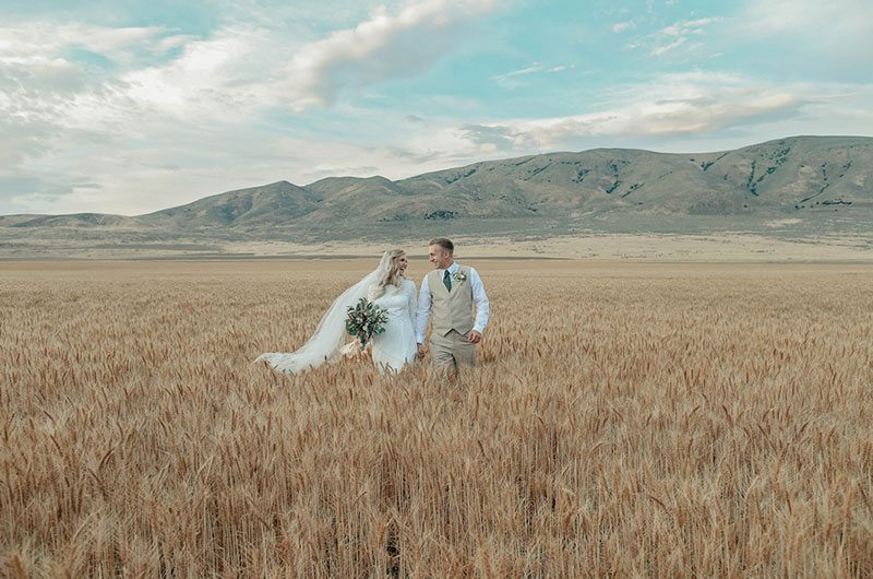 Bountiful Wheat Harvest Bride And Groom In Field
