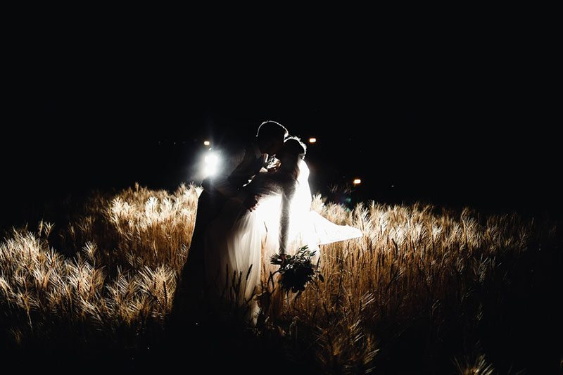 Bountiful Wheat Harvest Bride And Groom Kissing In Headlights