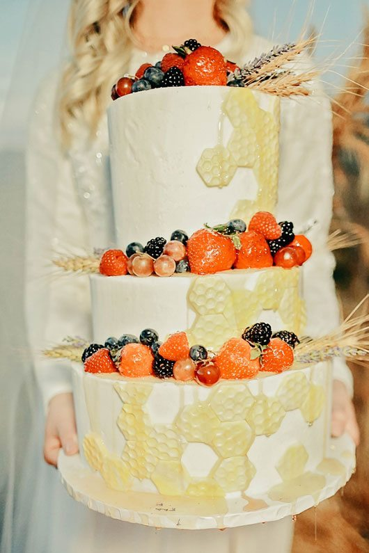 Bountiful Wheat Harvest Bride Holding Cake