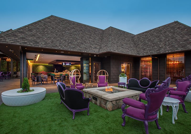 Grand Bohemian Roof Top Area With Purple Chairs