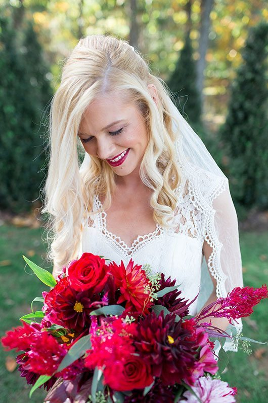 Halloween Wedding Bride Smiling With Flowers