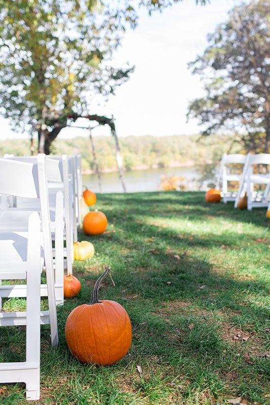 Halloween Wedding White Chairs And Pumpkins