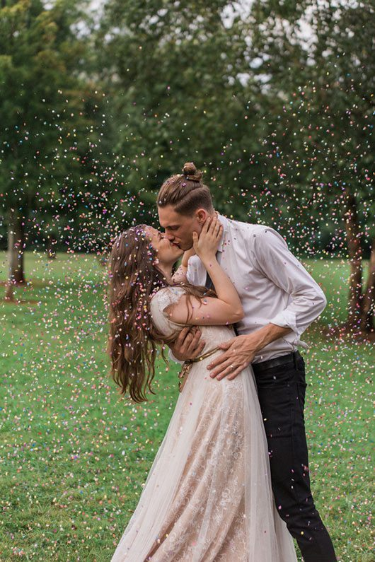 Rain Over Atlanta Bride And Groom Kissing With Confetti