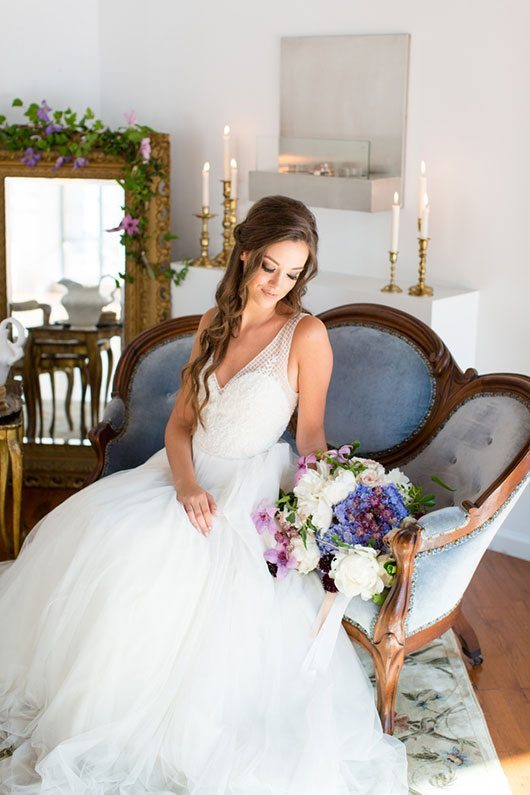 Enchanted Bride Holding Flowers On Couch