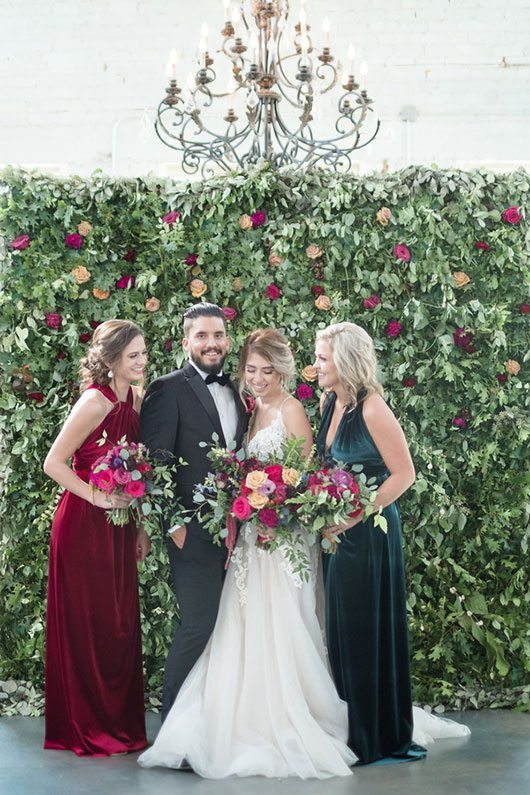Vintage Copper Bridal Party In Front Of Flower Wall