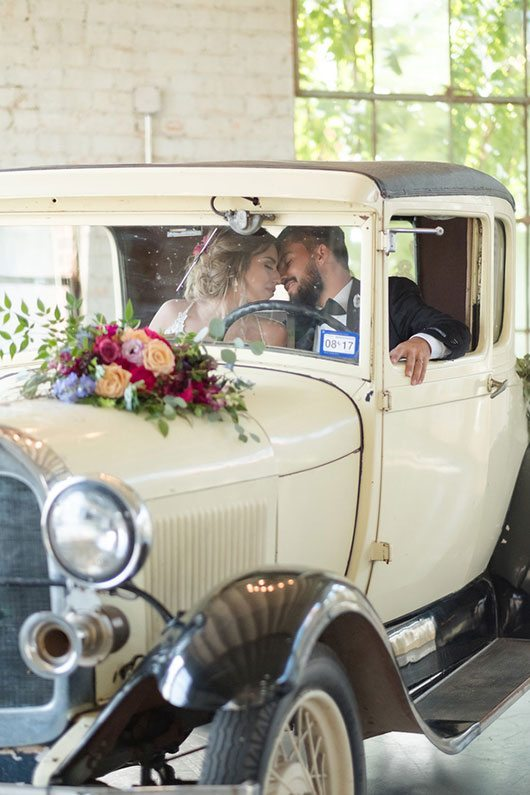 Vintage Copper Bride And Groom Inside Vintage Car