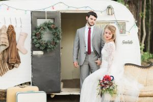 Eclectic Christmas Wedding Inspiration Christmas Bride And Groom In Front Of Airstream