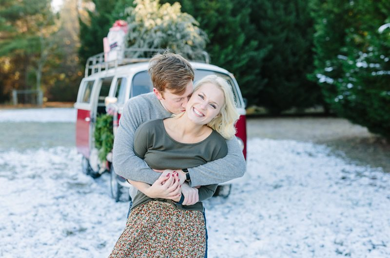 Merry Christmas Engagement Session Kissing Bride
