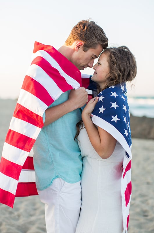 Patriotic Engagment Shoot Wrapped In Flag Hug