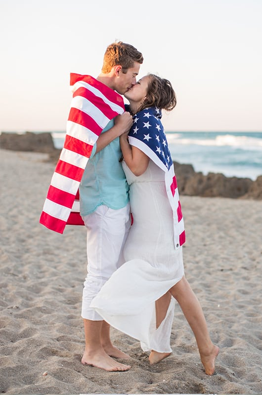 Patriotic Engagment Shoot Wrapped In Flag Kiss