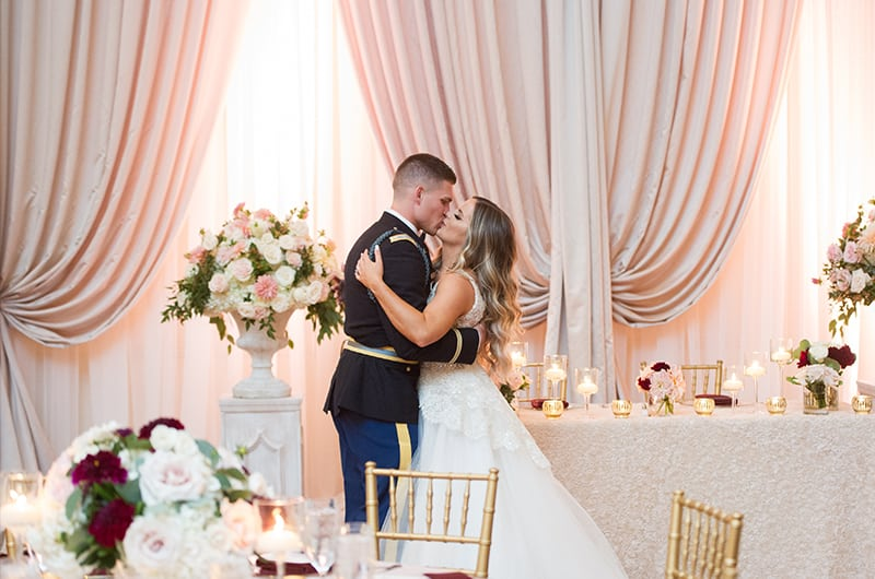 Casey Holmes Reception Kissing Near Table