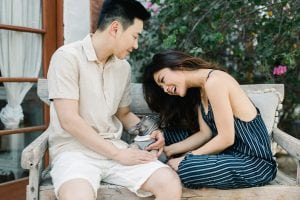 Kim Ye Engagement Landscape Bench Holding Dog