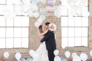 Pastel And Watercolor Styled Shoot Kissing In Balloon Room
