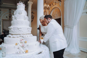 Salt Style & Events Presents Newlyweds HIllary & Brandon Couple Cutting Cake