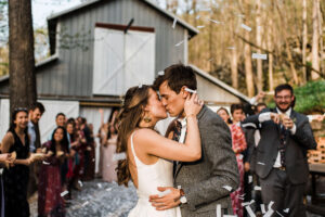 Newlyweds Becca & Louie Said I Do At Georgia's Oakleaf Cottage With Sustainability In Mind Couple Kiss