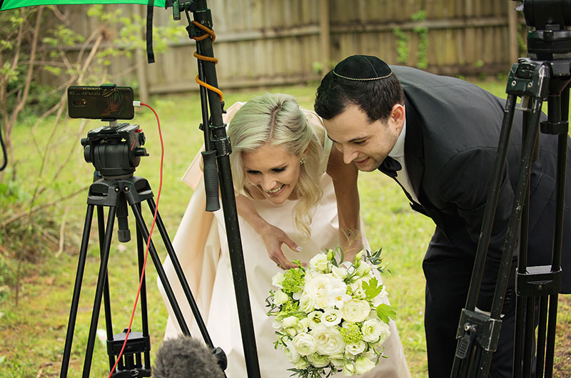 "Memphis Chef Josh Steiner & Marketing Director Wallis Tosi's Virtual At Home ""I Do"" Is Beyond Adorable Couple Looking At Pictures (1)"